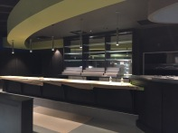 Unfinished bar and seating area near the front